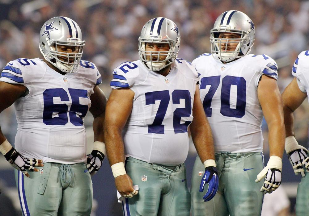 28 SEPTEMBER 2014: Dallas Cowboys guard Ronald Leary (65) and center Travis Frederick (72) and guard Zack Martin (70) during a regular season NFL football game between the Dallas Cowboys and the New Orleans Saints at AT&T Stadium in Arlington, TX.