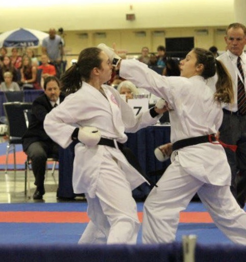 Junior Marisa Ruland (right), best known at Pace for her time on the soccer team, discusses her other love: Isshin-ryu karate.  Photo Courtesy of Marisa Ruland.