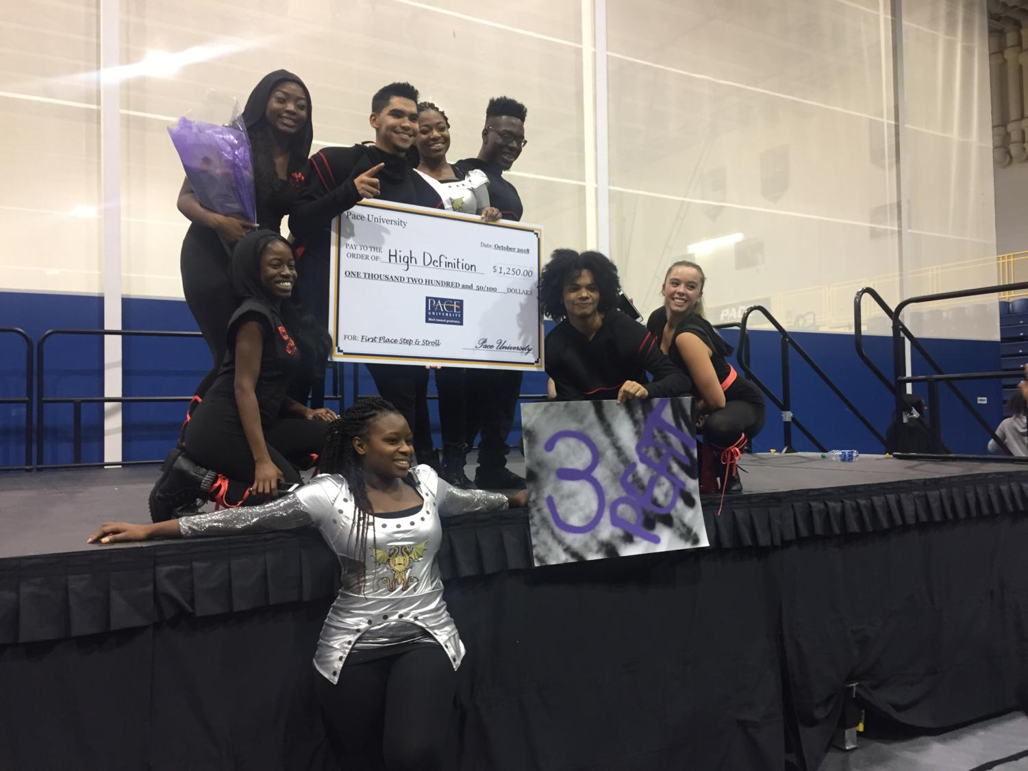 High Definition poses on the stage with their $1,250 prize after winning the Step and Stroll Competition
