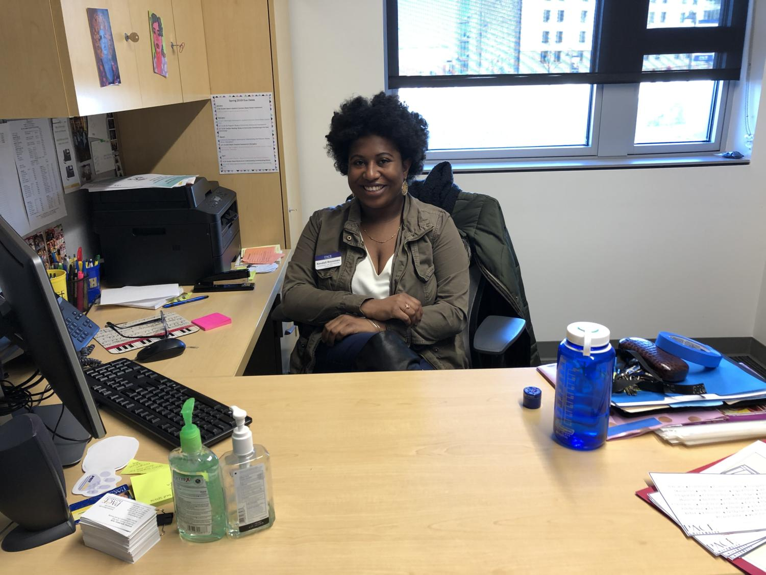 Kendall Rousseau sits in her office located by the entrance in Elm Hall.