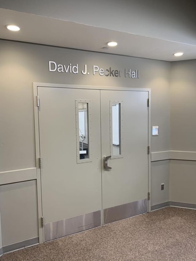 The+lecture+hall+named+after+David+Pecker+is+located+on+the+1st+floor+of+Wilcox.+
