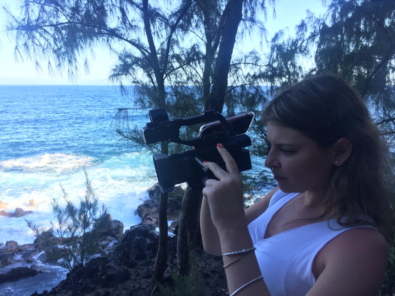 Talenti is pictured capturing footage of a black sand beach in Hawaii during production over Spring Break.