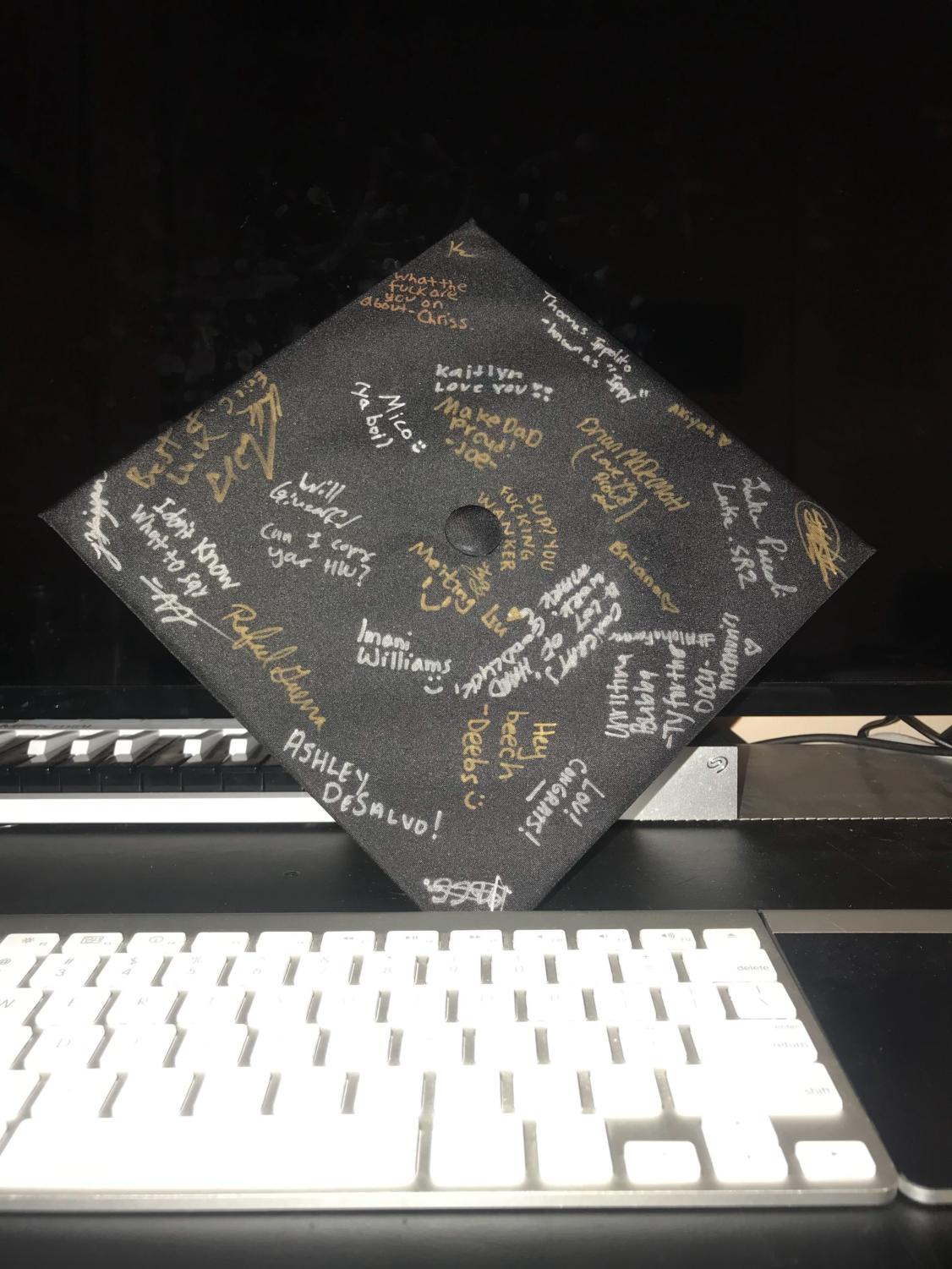 Seniors have the option of decorating their graduation cap for their big day. Many students, such as Jason Zhizpon, choose to get it signed by their friends to commemorate their final year at Pace.