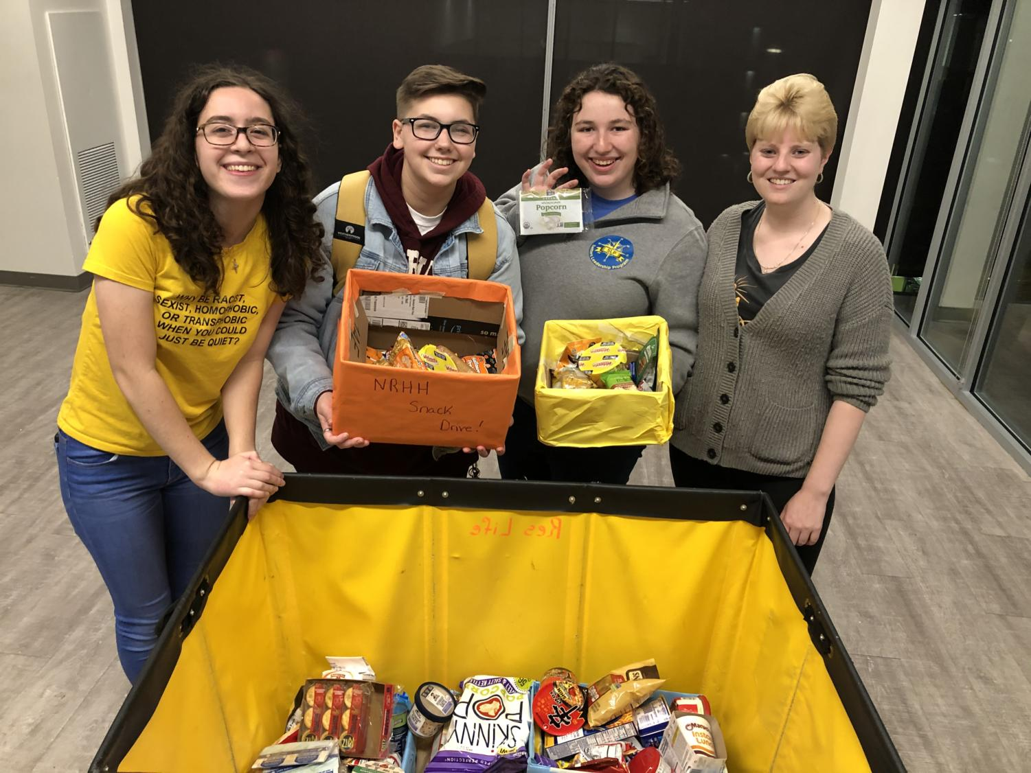NRHH members collecting food in the residence halls.  The E-board concludes Michael Shannon, Christina Little, Alexander Weiss, Meaghan Rodrigues and  Grainne McGinley.