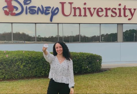 Decker took this picture after she successfully completed the Disney College Program training and received her official badge.