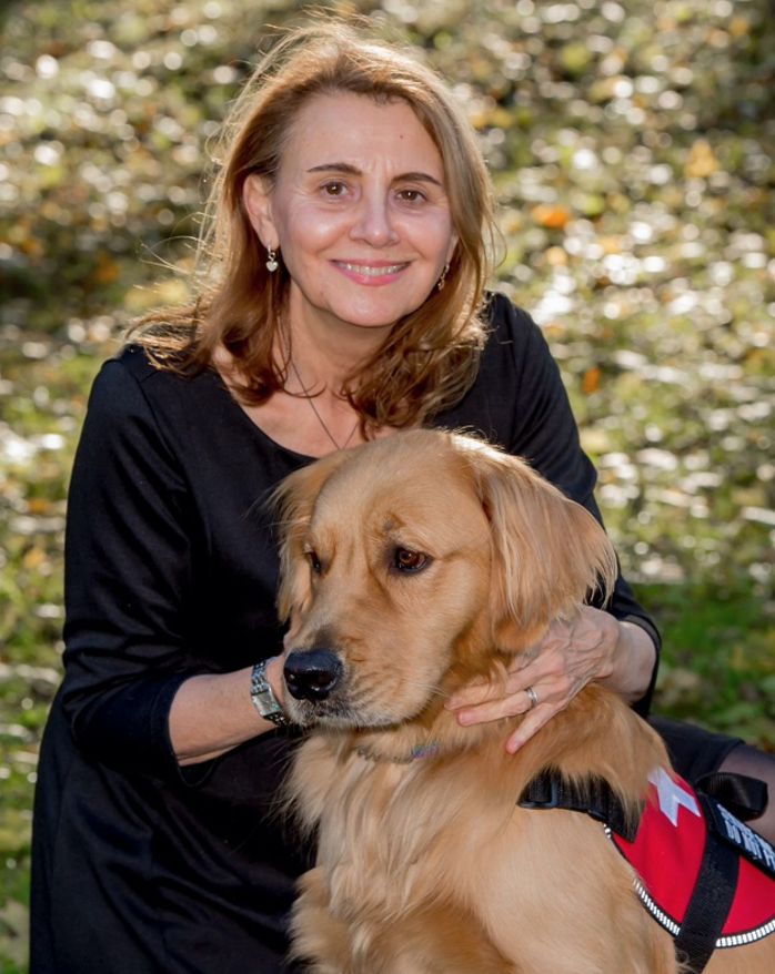 Professor Singleton and Professor Spirit. Spirit is Singleton's service dog, teaching, practice, and research partner.