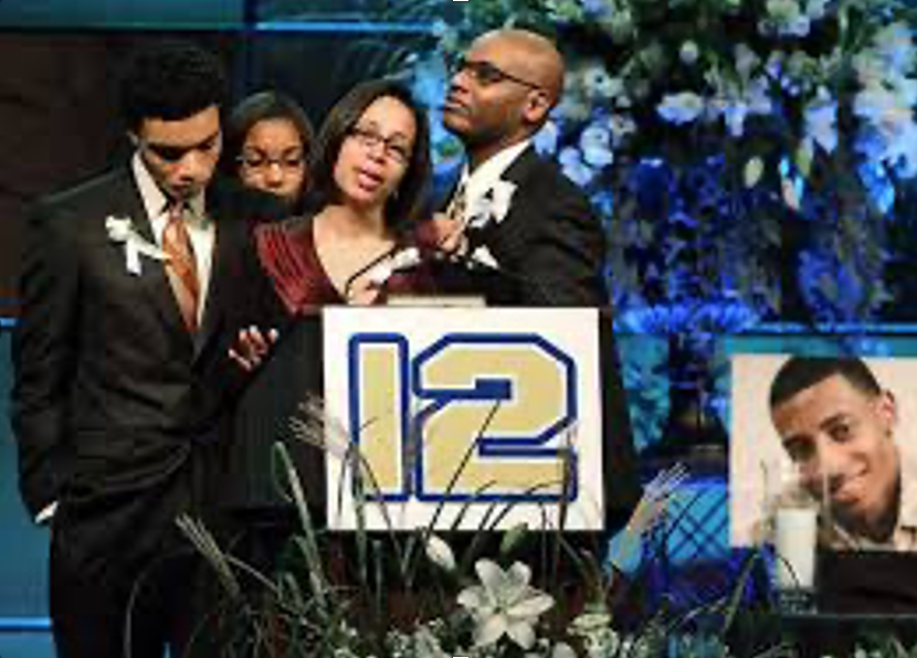 Henry's family honors him at his memorial service. #12 was his football  number and now will be retired from use in his honor.