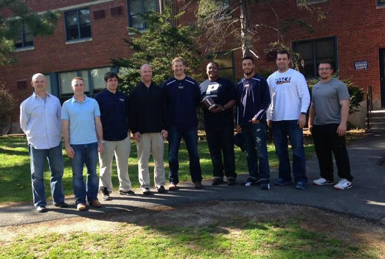From left: Head Coach Andrew Rondeau, Wide Receiver Coach and Recruiting Coordinator Robert Maffei, Running Back Coach Eric McCarthey, Assistant Coach, Defensive Coordinator and Linebacker Coach Corey Hetherman, Offensive Coordinator and Quarterback Coach Chad Walker, Offensive Line Coach Darnell Stapleton, Defensive Backs Coach Reggie Garrett, Tight End Coach Conor Gilmartin-Donahue and Defensive Line Coach Stephen Gruber. Not pictured: Strength and Conditioning Coordinator Michael Bohlander.