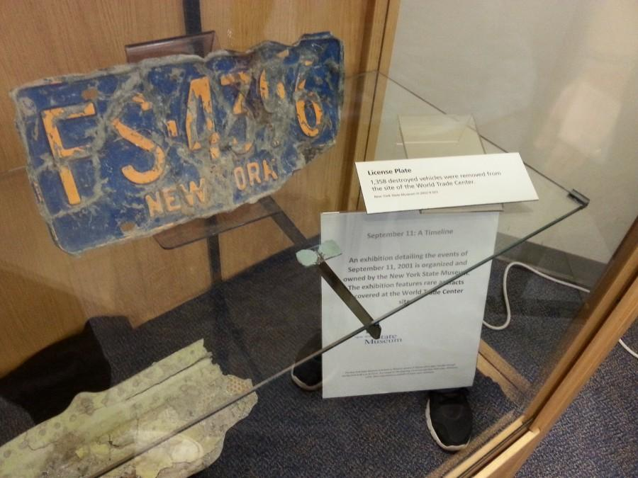 Students can view multiple artifacts from Ground Zero at the exhibit, including this burnt and battered New York license plate.
