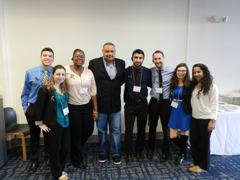 Pictured from left to right: Nelson Garcia, Cati Amaral, Brittany Spencer, Joshua Fredenburg, Steve Nahow, Jeff Domagala, Juliette Levine and Yolexis Rodriguez.