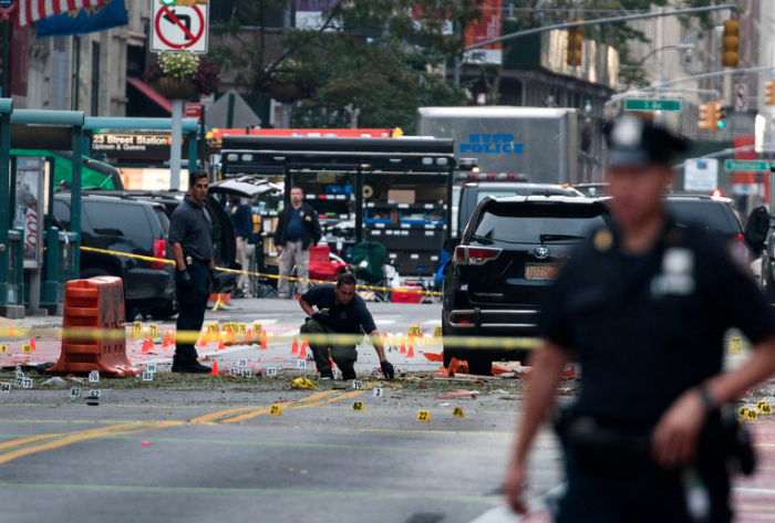 Authorities at the scene of the explosion. Photo courtesy of CNN.