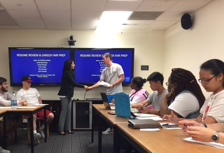 A student practices their introduction to an employer with Nicole Catalfamo. (Photo by Lia Tassinari)