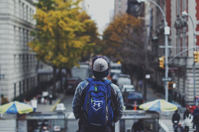 Student taking in a view of the city (Courtesy of Pexels)