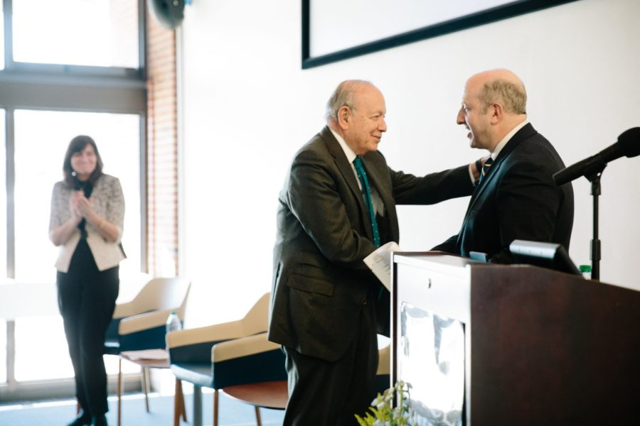 President Stephen Friedman shakes hands with the president-elect Marvin Krislov  (Courtesy of Pace University's Facebook Page)