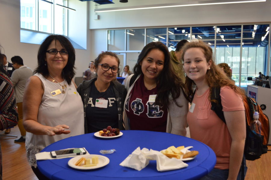 Faculty and students conversing at the First Generation Social. Photo courtesy of Katie Robustelli