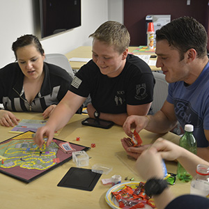 College students indulging in game night. Photo courtesy go google.