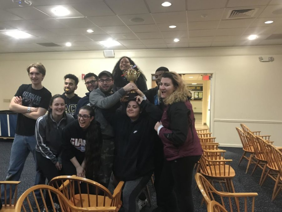 Participants after Elm Halls Manhunt event, posing with the best hall trophy.