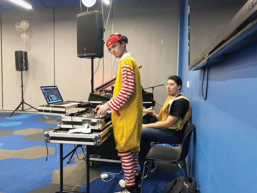 Several WPAW e-board members wore McDonald's costumes at the Open Mic Night event. Photo by Adiba Sikder.