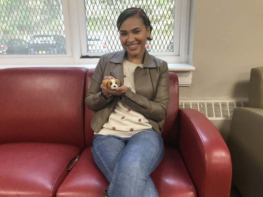 Sabrina Sanchez sitting in Martin Hall with her Beanie Baby, which she received as a birthday present.
