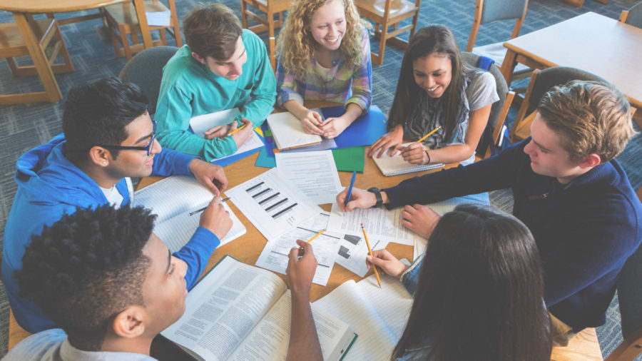 Students in a classroom engaging in group work. Photo courtesy of google.