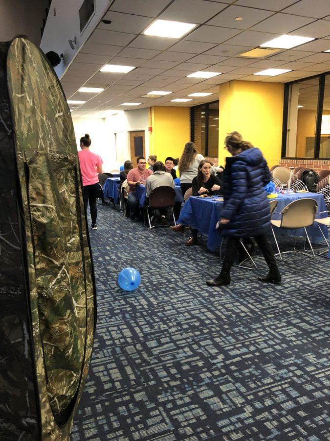 Students enjoying food and games at the Hanukkah Party