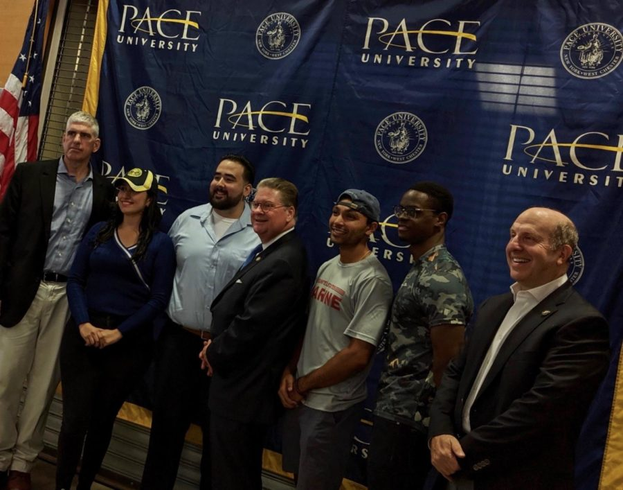 Pace+Veterans+stand+with+President+Krislov+and+Director+of+Veteran+Services+Peter+Riley+in+front+of+the+bookstore+where+the+Veteran+Lounge+will+be+placed.
