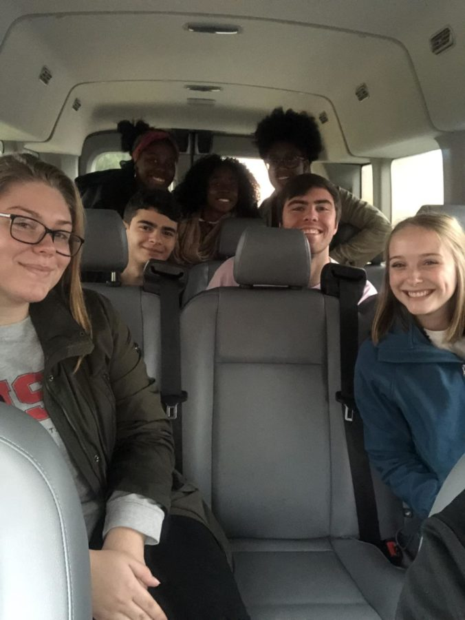 Students on the Voter Van run by the Center for Community Action and Research last year, 2018, on their way to the polls.