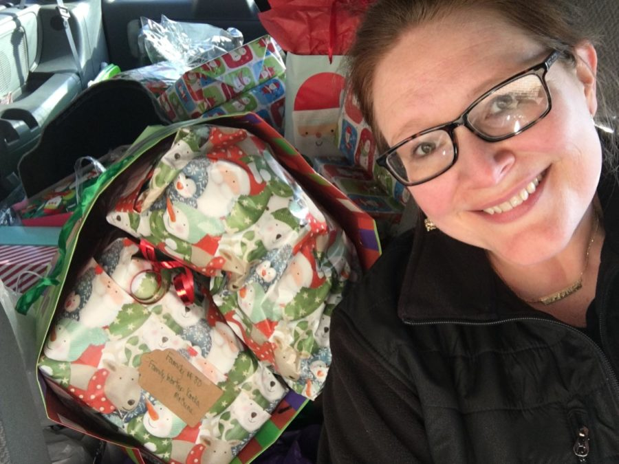 Dean Carpenter delivering the presents to Hope's Door. This year she expects to be delivering over 70 presents.