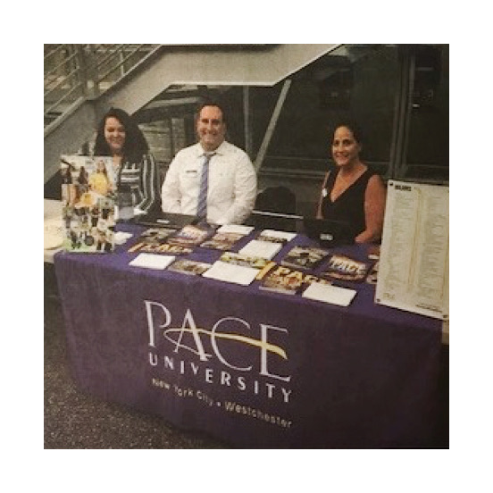 The admissions staff for the university set up a table at the Pace and WCC transfer agreement ceremony.