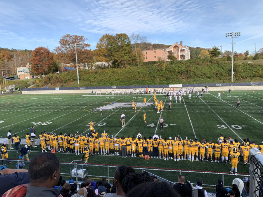 The Football line sporting their yellow jersey's at the homecoming game.