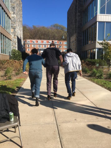 """Pi Lambda Phi raised $365 in their annual """"Walk a Mile in Her Shoes"""" event"""
