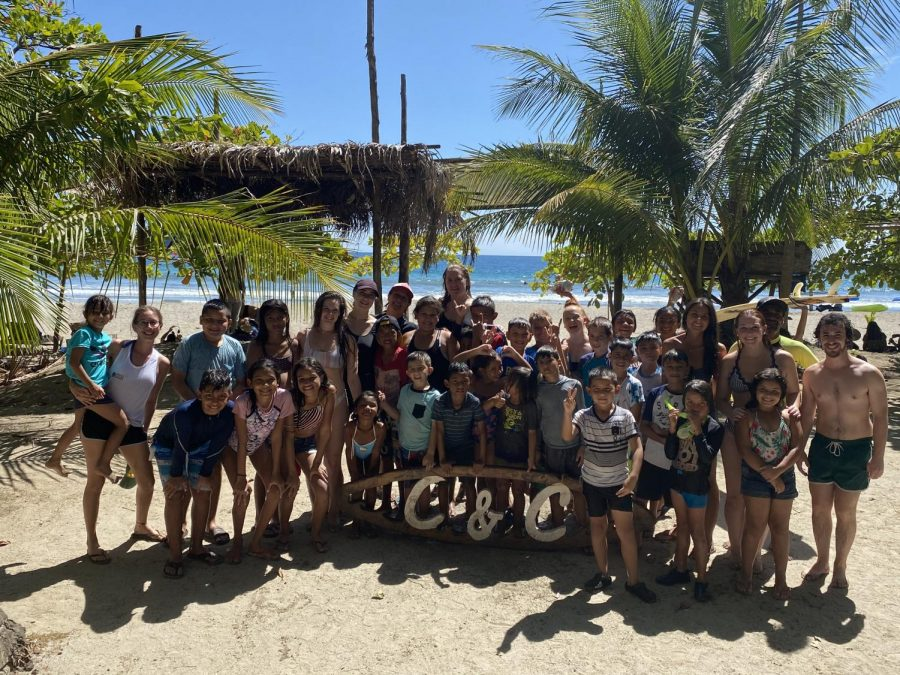 Alex Jareck stands with her class in Costa Rica, along with the children of CREER.