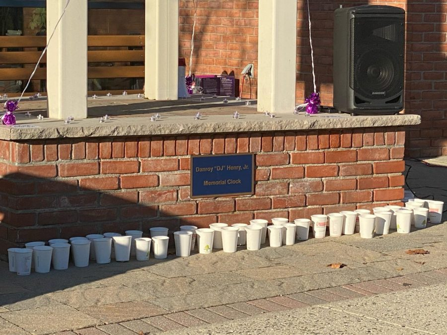 The base of the clocktower filled with candles as students remember DJ Henry's life.
