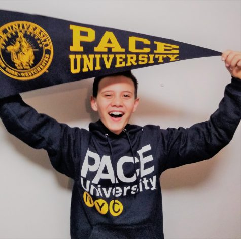 Shahab Gharib poses with Pace University merchandise after acceptance.